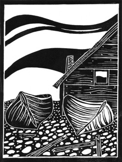 Black and white linocut of boats on a beach