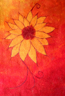 Felt wall hanging of a sunflower in orange and red