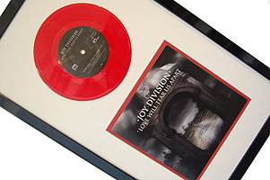 Framed Joy Division red vinyl single and sleeve