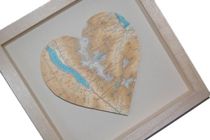Heart shaped map in a pale wooden frame
