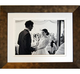Black and white wedding photgraph in a burnished gilt frame
